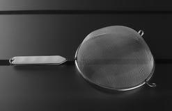 Metalliskt filter med det plast- handtaget Fotografering för Bildbyråer