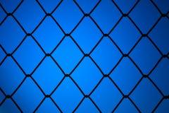 Metalliskt netto med blå bakgrund Fotografering för Bildbyråer