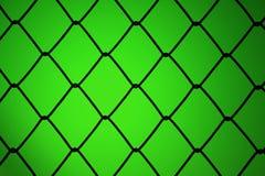 Metalliskt netto med grön bakgrund Fotografering för Bildbyråer