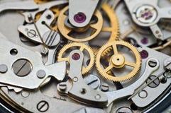 Metallkugghjul i urverk, begreppsteamwork Royaltyfri Foto
