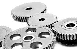 Metallkugghjul på white Arkivfoto