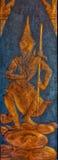 Metalllättnadsbild av buddistguden på Wat Kaew Korawaram Temp Arkivbilder