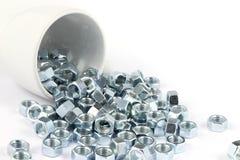 Metallmutter med koppen Arkivfoton