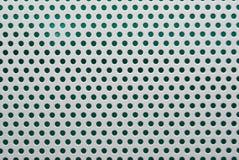 Metallo bianco perforato immagine stock