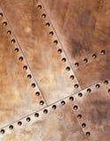 Metallo con i ribattini Fotografia Stock Libera da Diritti