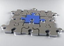 Metallo di puzzle del puzzle Fotografia Stock