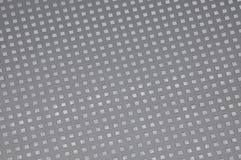 Metallo di superficie con i fori quadrati Immagine Stock Libera da Diritti