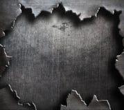 Metallo lacerato con il grande foro strappato fotografia stock