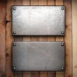 Metallo su fondo di legno Fotografia Stock Libera da Diritti