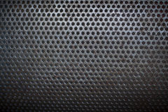Metalloberfläche mit vielen runden Löchern Stockfotografie