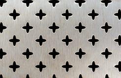 Metallperforierung eines Quermusters Lizenzfreies Stockfoto