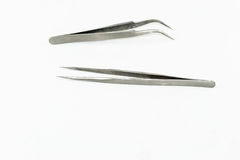 Metallpinzetten-Werkzeugisolat Lizenzfreie Stockbilder