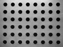 Metallplatta med många runda hål Arkivbild