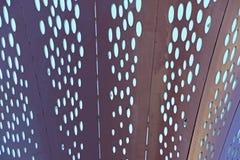 Metallplattor med ovala hål Arkivfoton