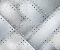Metallplattor roterade 45 grader med nitar bakgrund eller textur Arkivfoton