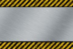 Metallschablone mit warnendem Streifen Stockbild