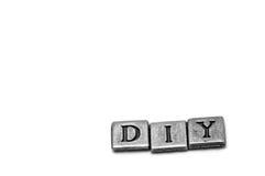 Metallscrapbooking Buchstaben, die DIY buchstabieren Lizenzfreies Stockfoto