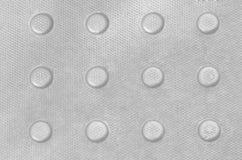 Metallspisgallertextur med den präglade modellen Royaltyfri Foto