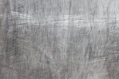 Metalltextur med skrapor Royaltyfri Foto