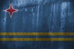 Metalltexutre eller bakgrund med den Aruba flaggan Fotografering för Bildbyråer