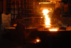 Metallugry. Glowing, molten hot steel. Stell casting Stock Photography