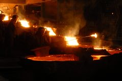 Metallugry. Glowing, molten hot steel. Stell casting Stock Image