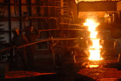 Metallugry. Glowing, molten hot steel. Stell casting Royalty Free Stock Images