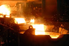 Metallugry. Glowing, molten hot steel. Stell casting Royalty Free Stock Photo