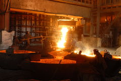 Metallugry. Glowing, molten hot steel. Stell casting Royalty Free Stock Photography