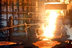 Metallugry. Glowing, molten hot steel. Stell casting Royalty Free Stock Image