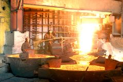 Metallugry. Glowing, molten hot steel. Stell casting Stock Photo