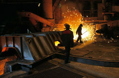 Metallurg takes a sample of steel in open-hearth workshop of metallurgical plant Royalty Free Stock Images