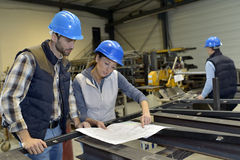 Metallurgic engineers working together Royalty Free Stock Image