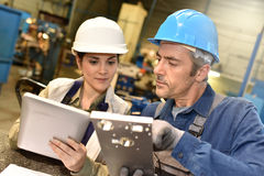 Metallurgic workers working with help of tablet Stock Image