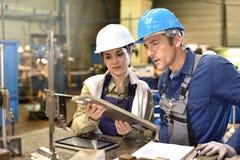 Metallurgic workers at workshop Royalty Free Stock Image