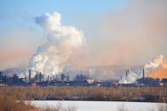 Metallurgical factory. Environmental contamination. Smoke pipe stock images