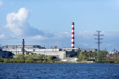 Metallurgical factory. Metallurgical plant on the shore of the pond Stock Image