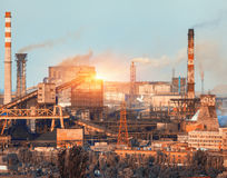 Metallurgical plant at colorful sunset. Industrial landscape. St stock image