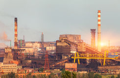 Metallurgical plant at colorful sunset. Industrial landscape. St stock photography