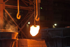 Metallurgical plant. Glowing ferroalloy. Glowing ferroalloy in a metallurgical plant stock image