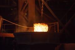 Metallurgical plant. Glowing ferroalloy. Glowing ferroalloy in a metallurgical plant stock images
