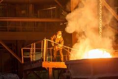 Metallurgical plant. Glowing ferroalloy. Glowing ferroalloy in a metallurgical plant stock photography