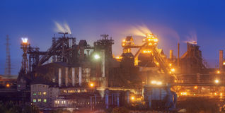 Metallurgical plant at night. Steel factory with smokestacks royalty free stock image