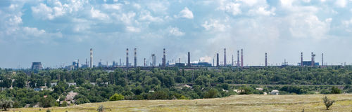 Metallurgical Plant. Panorama of ironworks in the middle of industrial city at noon Stock Images
