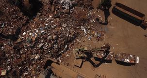 Metallurgical plant. Scrap heap, unloading of scrap metal factory, view from above, cover shot stock video footage