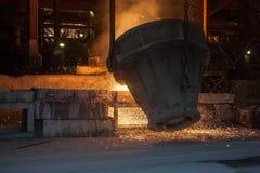 Metallurgical plant. Smelting metal. Smelting metal in a metallurgical plant stock photography