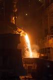 Metallurgical plant. Smelting metal. Smelting metal in a metallurgical plant royalty free stock image