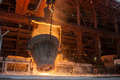 Metallurgical plant. Smelting metal. Smelting metal in a metallurgical plant royalty free stock photography