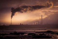 Metallurgical plant with smoking chimneys polluting the atmosphere.  royalty free stock photo