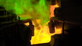 Metallurgical production. The molten metal is pouring from the furnace, the hot liquid is very dangerous. Modern technologies stock video footage